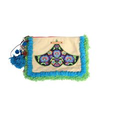 We love the Eden fringe here at SPIDER+LILY. This versatile clutch can also be used as an iPad cover (without edging on the iPad). Cream faux suede pocket, with machine embroidered front panel exclusive to SPIDER+LILY. Lime and aqua fringe and pom pom details with fuchsia cotton lining and beaded zip pull.   Large aqua pom pom dangle.  Our unique collection of treasure totes and accessories are exquisite in colour, amazing detail & artistry. Our signature plaited treasure braids & pom pom…