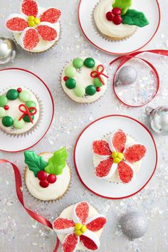 Christmas Candy Cupcakes - Enjoy tiny treats with trimmings such as M&M's and marshmallows. Pressed Laffy Taffy leaves lend a festive touch.