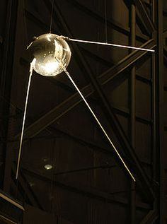 """Sputnik 1 (Russian: """"Cпутник-1"""" Russian pronunciation: [ˈsputʲnʲək], """"Satellite-1"""", ПС-1 (PS-1, i.e. """"Простейший Спутник-1"""",was the first artificial Earth satellite. The Soviet Union launched it into an elliptical low Earth orbit on 4 October 1957. The surprise success precipitated the American Sputnik crisis, began the Space Age and triggered the Space Race, a part of the larger Cold War. The launch ushered in new political, military, technological, and scientific developments"""