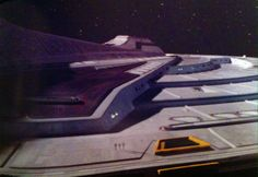 EVA on ventral side of Enterprise -E's saucer by Picard, Worf, and Hawk in 1996's ST: First Contact.