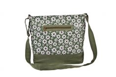 Our popular cross body bag is back in this eye-catching daisy design.  The bag has a long adjustable strap so that it can be worn across the body or on the shoulder.  The bag has a zip closure as well as numerous zip pockets.  It has a pretty cotton spotty lining.