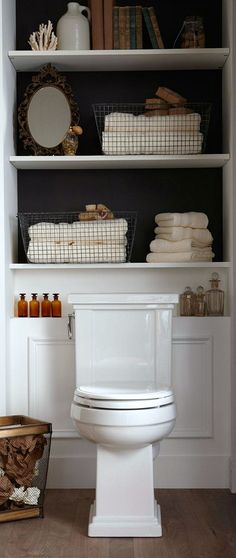 Adding built-in or freestanding shelving behind the toilet is a great way to add some extra storage in a small bathroom! #Toilets #BathroomToilets #smallbathroomtoilet