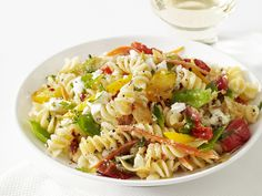 Celebrate the bright colors and bold flavors of spring by cooking this light and fresh pasta dish. After adding sweet cherry tomatoes to al dente noodles, s