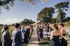 Here comes the bride - backyard wedding by the river | fabmood.com #wedding #backyardwedding #fallwedding #sunflowerthemed