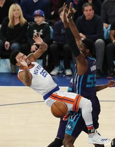 New york knicks carmelo anthony hits a jump shot in the first half new york knicks derrick rose collides with charlotte hornets roy hibbert in the first half at voltagebd Choice Image