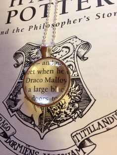 Harry Potter Draco Malfoy Book Page Necklace by EnchantingGlass