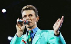 David Bowie performing in 1992, I love that color of his suit!