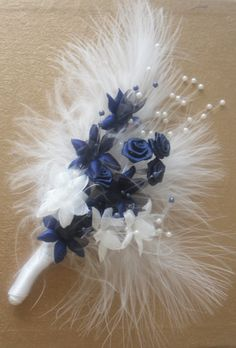 Corsage in Navy and White with ribbon roses, gyps, pearls and feathers