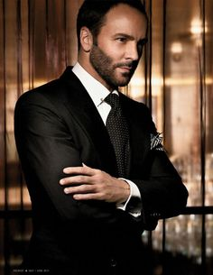 Beard and suit but smooth.