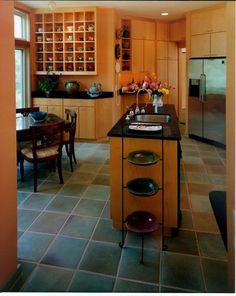 ceramic kitchen floor tiles by New Inspiration Home Design.  Love the tea pots in the cubbies too!