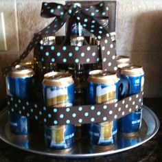 """""""Beer"""" cake- Having a couples baby shower?  Make a diaper cake for her, and a beer cake for him!"""