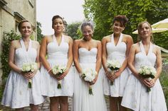 The white bridesmaid dresses are awesome.