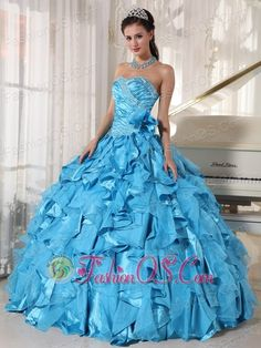 Beautiful Aqua Blue Quinceanera Dress Sweetheart Floor-length Organza Beading Ball Gown http://www.fashionos.com The sweetheart neckline quinceanera dress encrusted with beadings which are scattered on the bodice. The handed flower at the waist side adds more interest to the midsection.Layers of ruffles in contrasting taffeta and tulle makes the skirt stunning and fabulous.
