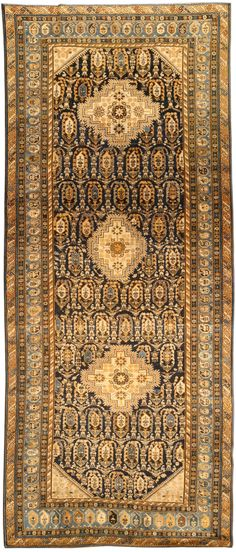 An antique Caucasian Kuba runner BB4557 - A late 19th century Caucasian Kuba runner, the black field with staggered atypically angular botehs around three ...