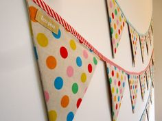 bunting...could use scrapbook paper to add more pops of orange in the girls' playroom.