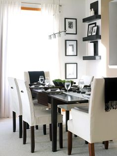 Next on the list is a dining room. I can't wait till my boys grow up and I make dinner and they tell me about their day. I love the black and white. And i have always adored these style of chairs.