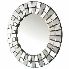 "Round wall mirror with a 3-dimensional frame.        Product: Wall mirror    Construction Material: Wood and mirrored glass    Color: Silver       Dimensions: 40"" Diameter"