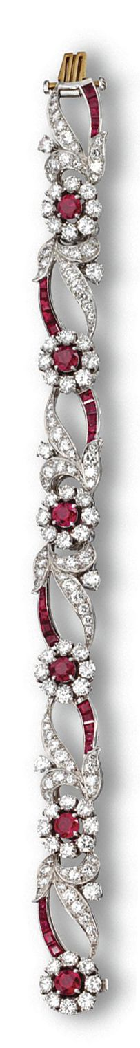 RUBY AND DIAMOND BRACELET, TIFFANY & CO, CIRCA 1950.  Decorated at regular intervals with flowerheads flanked by leafy sprays and tendrils, set with 6 round rubies weighing approximately 2.50 carats, 138 round diamonds weighing approximately 8.00 carats and numerous calibré-cut rubies, mounted in platinum, length 6¾ inches, signed Tiffany & Co.