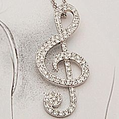 Silver Rhinestone Treble Clef Necklace Beautiful and new! Jewelry Necklaces