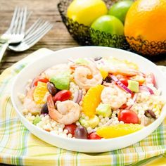 Light and flavorful Citrus Shrimp Couscous Salad with orange, tomato, onion, olives, avocado, and citrus juices.