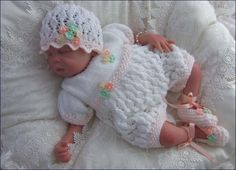 Amelia. PATTERN: Sized to fit a Newborn Baby but also suitable to fit an 19-21 Reborn Doll Pattern requires Double Knitting Yarn, ribbon and optional crochet flower embellishments
