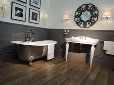 The Admiral Tub by Devon & Devon, noted for its cast iron construction and copper-color enamel finish, and the white ceramic Serenade Console which complement each other beautifully. All Devon & Devon products are designed and built in Italy, with showrooms across Europe and are distributed in North America through Watermark Designs.