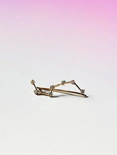 Free People Big Dipper Diamond Earring. Slip on earring made from 14k gold and diamonds. Shine bright like the constellation this piece represents. Sold as a single.