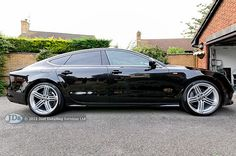 Well I have posted photos of other cars, so thought it was time I posted one of my  own car!, a Phantom black Audi A7.  This photo was taken last August, just after I had the car professionally detailed.