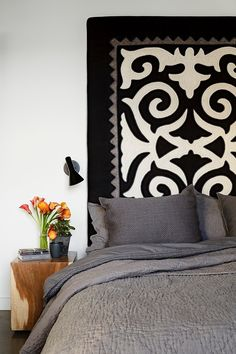 Gorgeous bedroom - love the rug/throw as headboard NW 13th Avenue Loft by Jessica Helgerson Interior Design