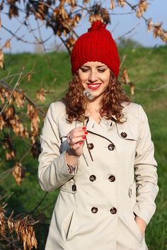 Girl with red cap holding dandelion