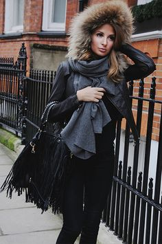 Millie Mackintosh. Leather jacket, scarf, jeans, boots.