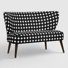 Boasting a mid-century-modern-inspired silhouette, our plush, custom-made loveseat is handcrafted of solid pine with bold black and white dot-patterned cotton upholstery.
