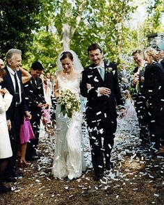 A couple is showered with biodegradable white confetti