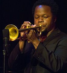 Ambrose Akinmusire (ah-kin-MOO-sir-ee; born May 1, 1982) is an American jazz trumpeter. In 2007, Akinmusire was the winner of both the Thelonious Monk International Jazz Competition and the Carmine Caruso International Jazz Trumpet Solo Competition, two of the most prestigious jazz competitions in the world.[1][2] In 2014 he won the North Sea Jazz Festival's Paul Acket Award Akinmusire was as a member of the Berkeley High School Jazz Ensemble