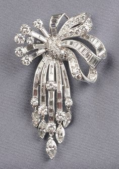 Cartier: Platinum and Diamond Brooch, designed as a bow, set with marquise-, full-, and baguette-cut diamond melee Cartier Jewelry, Diamond Jewelry, Antique Jewelry, Vintage Jewelry, High Jewelry, Modern Jewelry, Faberge Eier, Diamond Brooch, Pendant Set