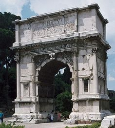 """East Facade of the Arch of Titus, Rome, Italy, after 81 CE, freestanding, arcuated opening (curved), composite capitals (made from both ionic and corinthian) """"fourth style"""", interation between both mortals and immortals, belief that after death emperors became gods,"""