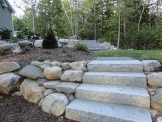 Partial retaining wall, very rough, to cheek in stairs, but feathers out to natural slope.