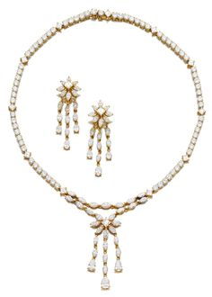 DIAMOND DEMI-PARURE, CARTIER.  Comprising: a necklace set with brilliant-, carré-cut and marquise-shaped diamonds, length approximately 365mm; and a pair of pendent earrings similarly set, post and hinged back fittings; each signed Cartier, Paris and numbered, French assay and partial maker's marks.