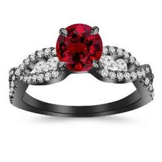 This is gorgeous. Black Gold Round Ruby Red Diamond Ring