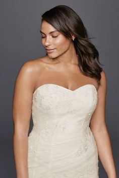 Let your personality shine through in this electrifying strapless trumpet wedding dress. Featuring lace appliques and a sweetheart neckline, this gown will seal the deal for the perfect wedding you have always envisioned.  David's Bridal Collection - Plus Size.  Also available in Regular. Check your local stores for availability.  Sweep train. Fully lined. Back zipper. Imported. Dry Clean only. Cherish your wedding dress forever with our Gown Preservation Kit.