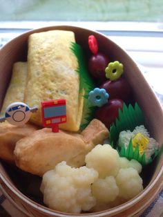 Egg roll stuffed with rice & fish shaped tofu and mini Nutella flower for dessert