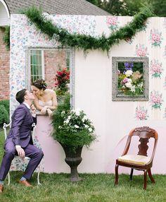 Fun photobooth wallpapered wall