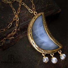 Spirit Moon  - Stained Glass Crescent Moon Pendant. $86.00, via Etsy.
