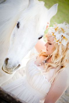 lovely photo of bride with her horse. Can't have a country wedding without a horse