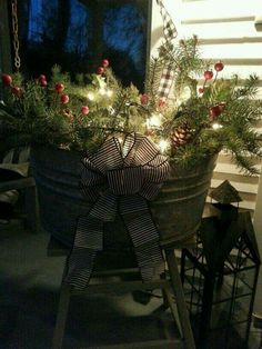 Easy Christmas porch decor idea: fill any metal or wood bucket or wicker basket with gathered twigs, branches, evergreens, ornaments,etc. then pile on a strand of Christmas lights! Christmas Porch, Farmhouse Christmas Decor, Primitive Christmas, Country Christmas, Christmas Fun, Christmas Planters, Christmas Lights, Winter Porch Decorations, Christmas Inspiration