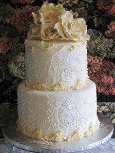 Ivory and white cake. Lace, roses and the most delicate filigree piping.