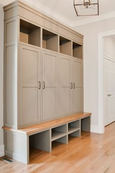 Walk through mud room with storage on the side. Custom Built-in lockers in mud room - Warn Stone, Sherwin Williams - Farinelli Construction Mudroom Cabinets, Mudroom Laundry Room, Mud Room Lockers, Mudroom Cubbies, Mudroom Storage Ideas, Bench Mudroom, Hallway Coat Storage, Small Mudroom Ideas, Kids Cubbies