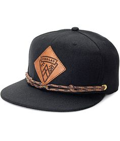 e080f3a3ce3 The Lockport black snapback hat from Findlay has a black construction with  a leather logo patch