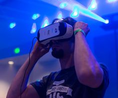 Why Does Virtual Reality Make Some People Sick? Guy tries virtual glasses headset during VRLA Expo, virtual reality exposition, event at the Los Angeles Convention Center in Los Angeles in August Augmented Reality, Virtual Reality, Space Tourism, Ar Technology, Android, Future Trends, Online Gambling, Immersive Experience, Marketing Plan