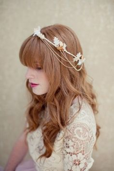 Super cute hair accessory for a summer wedding especially. Probably wouldn't go with the hairstyle you want, but for bridesmaids something like this could be super cute I think. Or even the flower girls.